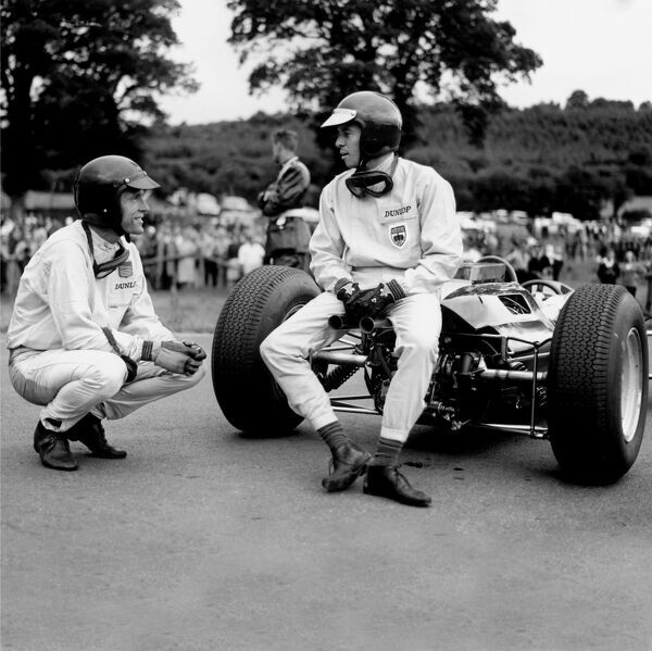 1964 Belgian Grand Prix. Spa-Francorchamps, Belgium. 12-14 June 1964. Jim Clark (Lotus 25-Climax) talks to Dan Gurney (Brabham BT7-Climax). Both had just run out of fuel but Clark had already finished in 1st position. Ref: 24999B World Copyright