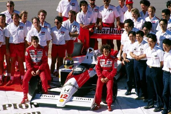 Formula One World Championship: Ayrton Senna and Alain Prost the McLaren Honda team celebrate winning both constructors and drivers championship