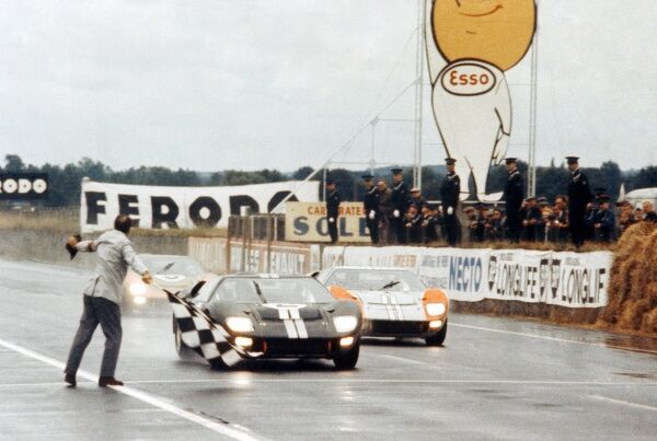 Le Mans 24 Hour Race: Bruce McLaren and Chris Amon Ford GT40 Mk II take the chequered flag to win just ahead of Shelby American Inc. team mates Denny Hulme
