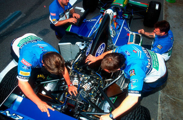 1994 Spanish Grand Prix.  Barcelona, Spain.  27-29 May 1994.  Benetton mechanics take a look at Michael Schumacher's Benetton B194 Ford.   Ref-94 ESP 26.  World Copyright - LAT Photographic