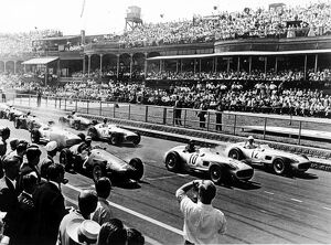 1955 British Grand Prix: Stirling Moss, Juan Manuel Fangio and Jean Behra lead Karl Kling