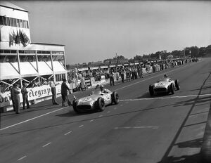 1955 British Grand Prix: Stirling Moss leads Juan Manuel Fangio in 1st and 2nd positions