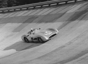 1955 Italian Grand Prix: Stirling Moss, retired, on the banking, action