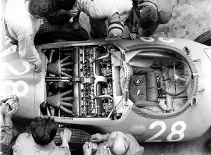 1956 French Grand Prix: Mechanics look at the straight 8 Bugatti 251 engine in Trintignant's