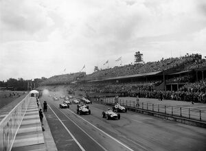 1957 British Grand Prix: Jean Behra, retired, leads at the start, with Stirling Moss