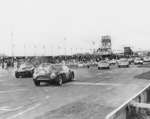 1961 RAC Tourist Trophy: Jim Clark, 4th position, leads Stirling Moss, 1st position