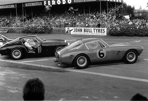 1961 RAC Tourist Trophy: Stirling Moss, 1st position, leads Mike Parkes, 2nd position