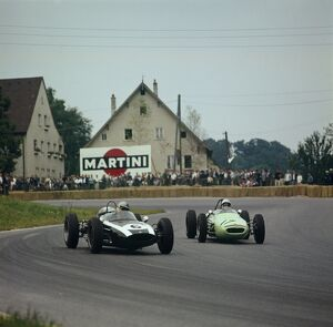 1961 Solitude Grand Prix: Stirling Moss, retired, chases Jack Brabham, 5th position