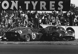 1962 RAC Tourist Trophy: John Surtees, retired, up against the Jim Clark, retired, action
