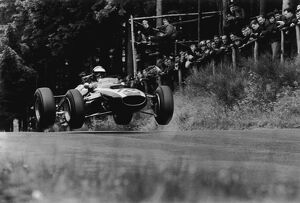 1965 German Grand Prix - Jochen Rindt: Jochen Rindt 4th position, jumping action