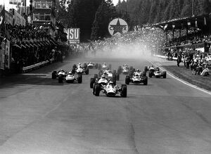 1967 Belgian Grand Prix: Jim Clark, Lotus 49-Ford, 6th position, leads Jochen Rindt