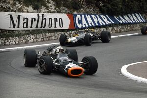 1969 Monaco Grand Prix: John Surtees, B.R.M. P138, retired, leads Jack Brabham, Brabham BT26-Ford