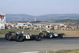 1969 United States Grand Prix: Piers Courage, 2nd position leads Jack Brabham, 4th position