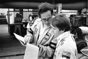 1980 German Grand Prix: Gilles Villeneuve with team director Mauro Forghieri in the pits