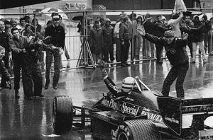 1985 Portuguese Grand Prix: Ayrton Senna celebrates 1st position with Team Manager