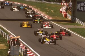 1987 Hungarian Grand Prix: Nigel Mansell leads Gerhard Berger and Michele Alboreto