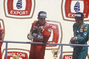 1988 Canadian Grand Prix: Ayrton Senna 1st position and Thierry Boutsen 3rd position, on the podium