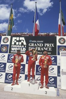1988 French Grand Prix: Alain Prost, 1st position, celebrates with Ayrton Senna, 2nd position