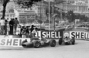Monte Carlo, Monaco. 22 May 1966: John Surtees, Ferrari 312, retired, leads Jackie Stewart