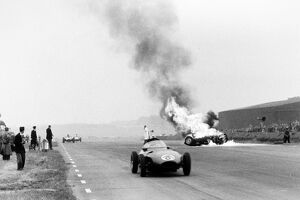 Silverstone, Great Britain. 14 July 1956: Tony Brooks's BRM P25 burns after he